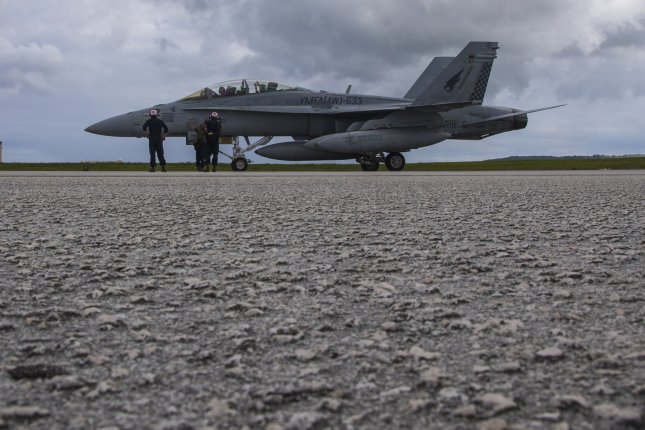 An F/A-18D Hornet with Marine All Weather Fighter Attack Squadron is inspected post-flight during Exercise Forager Fury 18 at Andersen Air Force Base, Guam on Sept. 26. Marine Corps photo by Lance Cpl. Seth Rosenberg