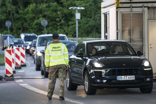 Vehicles queue to cross the border into Germany at a checkpoint in Froeslev, Denmark, on Monday after the border was reopened for the first time since March due to the COVID-19 crisis. Photo by Claus Fisker/EPA-EFE