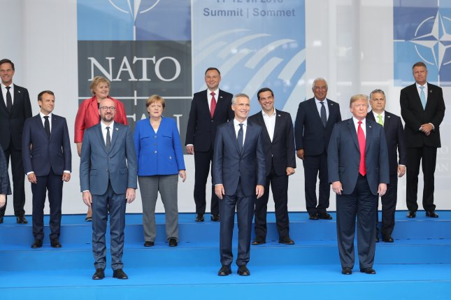 Ten NATO-member nations are now spending above 2% of their GDP on defense, according to a new report, six years after adopting the standard. Pictured, NATO heads of state take at a 2018 summit of the alliance. Photo by Oliver Hoslet/EPA-EFE
