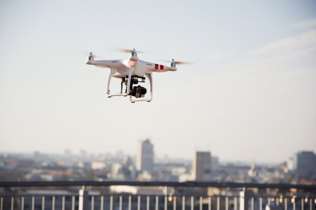 A quadcopter drone with mounted camera. Photo by Newnow/Shutterstock