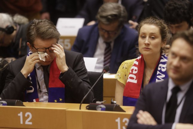 Assistants of the European Parliamentary Labor Party (EPLP) wipe away tears Wednesday during a meeting ahead of their last plenary session of the European Parliament in Brussels, Belgium. Photo by Oliver Hoslet/EPA-EFE