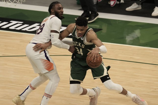 Milwaukee Bucks forward Giannis Antetokounmpo (R) drives past Phoenix Suns forward Jae Crowder (L) during the fourth quarter in Game 3 of the 2021 NBA Finals on Sunday at Fiserv Forum in Milwaukee. Photo by Tannen Maury/EPA-EFE