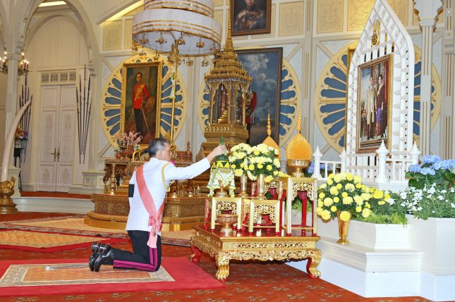 Thailand's new King Maha Vajiralongkorn Bodindradebayavarangkun pays respect to a portrait of the late Thai King Bhumibol Adulyadej and Thai Queen Sirikit during the accession to the throne proclamation ceremony at the Ambara Villa of the Dusit Palace in Bangkok on Thursday. Thailand has new king after Crown Prince Maha Vajiralongkorn, 64, accepted to ascend the throne to become the country's new monarch, the 10th King of the 234-year-old Chakri Dynasty. The King Maha Vajiralongkorn Bodindradebayavarangkun succeeds his father, Thai King Bhumibol Adulyadej, the world's longest reigning monarch, who died at the age of 88 in Siriraj hospital on October 13. Photo courtesy Royal Household Bureau/European Pressphoto Agency