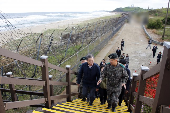 President Moon Jae-in (L) inspects a trail adjacent to the Demilitarized Zone (DMZ), dubbed the DMZ Peace Trail, in the northeastern border town of Goseong on April 26, 2019. Photo by Yonhap News Agency