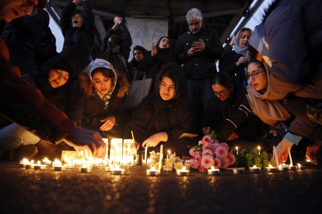 Iranians light candles for victims of the Ukraine International Airlines flight that was shot down by Iran as they protest in front of the Amir Kabir University in Tehran on January 11. Photo by Abedin Taherkenareh/EPA-EFE