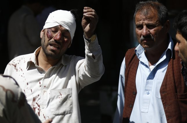 A man injured in a suicide bomb attack Wednesday in Kabul, Afghanistan's capital, reacts at the scene. Photo by Hedayatullah Amid/EPA