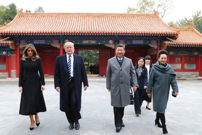 U.S. President Donald Trump, first lady Melania Trump, Chinese President Xi Jinping and his wife Peng Liyuan walk at the Palace Museum in Beijing Wednesday. Photo by Xinhua/EPA