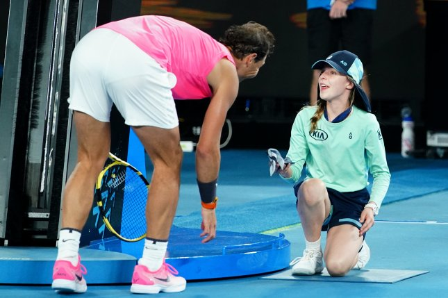Rafael Nadal says sorry with a kiss after hitting ball girl
