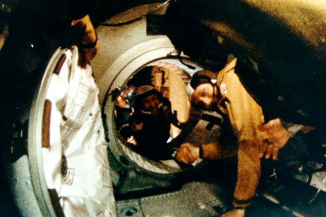Astronaut Thomas P. Stafford (f.g.) and cosmonaut Aleksei A. Leonov shake hands after a successful Apollo-Soyuz linkup in space on July 17, 1975. This is the 40th anniversary of the joint American and Russian space mission. File photo by NASA History Office