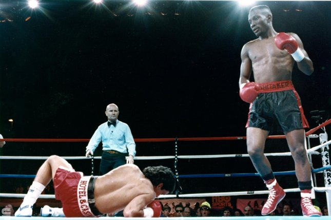 Pernell Sweetpea Whitaker (R) had a 40-4-1 career record with 17 knockouts. He also won a gold medal at the 1984 Olympics and beat Juan Nazario in a 1990 WBA/IBF/WBC lightweight championship bout (pictured). File Photo by Terry Schmitt/UPI