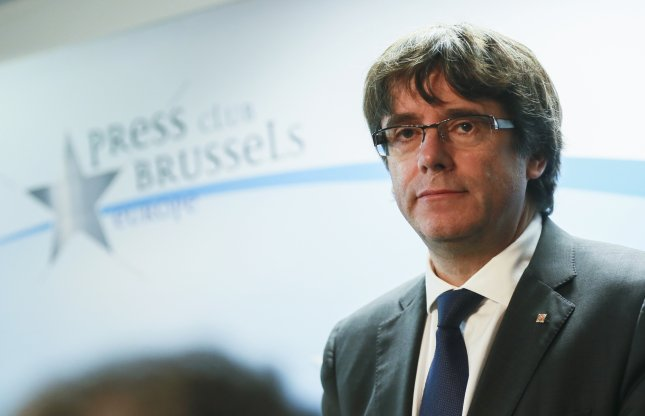 Former Catalan President Carles Puigdemont and four other dismissed Catalan officials turned themselves in to authorities in Belgium on Sunday. Photo by Olivier Hoslet/EPA