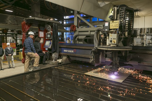 U.S. Sen. Susan M. Collins makes the initial cut of steel for the future USS Patrick Gallagher at Bath Iron Works in Maine. The vessel is set to be the last Flight IIA ship of the Arleigh Burke-class of destroyers. Photo by U.S. Navy