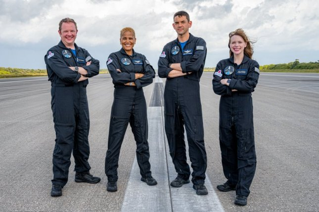 The crew of the all-private, philanthropic Inspiration4 mission stands on the former space shuttle landing strip at Kennedy Space Center in Florida after arrival Thursday for launch on Wednesday. Photo courtesy of Inspiration4