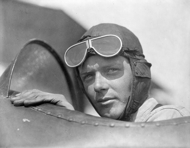 Aviator Charles Lindbergh, wearing a helmet and goggles, is pictured in the open cockpit of airplane at Lambert Field, in St. Louis, Miss., ca. 1920s. File Photo by Library of Congress/UPI