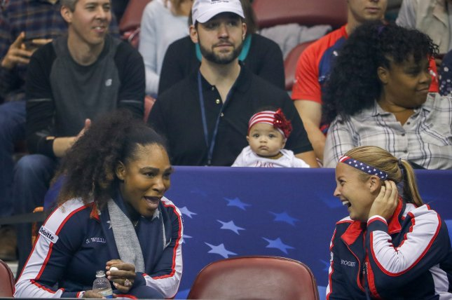 Serena Williams (L) of the US speaks with Shelby Rogers (R) as Williams' husband Alexis Ohanian (C) holds their daughter Alexis Olympia Ohanian Jr. during a 2018 Fed Cup World Group first round women's tennis match between the United States and the Netherlands at the US Cellular Center in Asheville, N.C. Photo by Erik S. Lesser/EPA-EFE