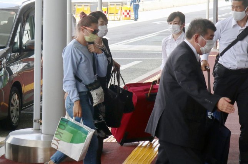 Belarusian runner Krystsina Tsimanouskaya arrives on Wednesday at Narita International Airport near Tokyo, Japan, to board a flight to Austria. Photo by Jiji Press/EPA-EFE