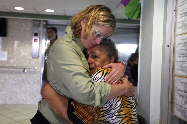 New government data show deaths increase by more than 1,400 after Hurricane Maria. San Juan's Mayor Carmen Yulin Cruz (L) is pictured hugging a woman during her visit to an elderly home in San Juan, Puerto Rico, a couple days after the storm devastated the island on Sept. 20. EPA-EFE/THAIS LLORCA