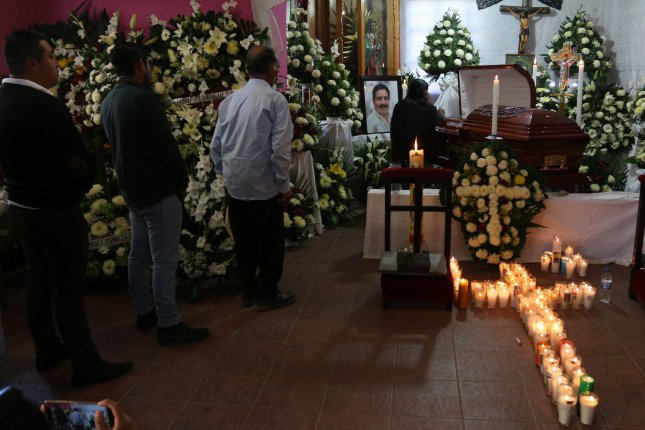 Mourners attend the funeral of Tlaxiaco Mayor Alejandro Aparicio, who was slain a few minutes after taking office on January 1. Photo by EPA-EFE
