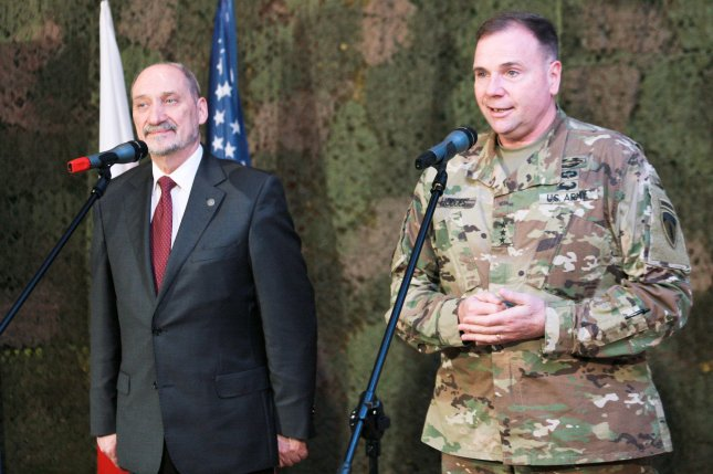 Polish Defence Minister Antoni Macierewicz (L) and the Commander of the U.S. Army in Europe, General Frederick Hodges (R), hold a press conference after their meeting in the 11th Lubuska Armoured Cavalry Division in Zagan, western Poland on December 14, 2016. Hodges said that at the beginning of 2017, approximately 4000 U.S. soldiers are due to arrive in Poland. Photo by Lech Muszynski/European Pressphoto Agency