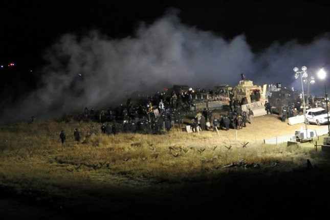 Police and protesters clash on the Backwater Bridge, north of a protest camp in North Dakota's Morton County on November 20. Police said about 400 protesters attempted to breach the bridge, which was blocked since late October, near the site of the Dakota Access pipeline. On Monday, police said three people were arrested for attempting to enter private property near the Dakota Access Pipeline's horizontal drill pad. Photo courtesy of Morton County Sheriff's Department
