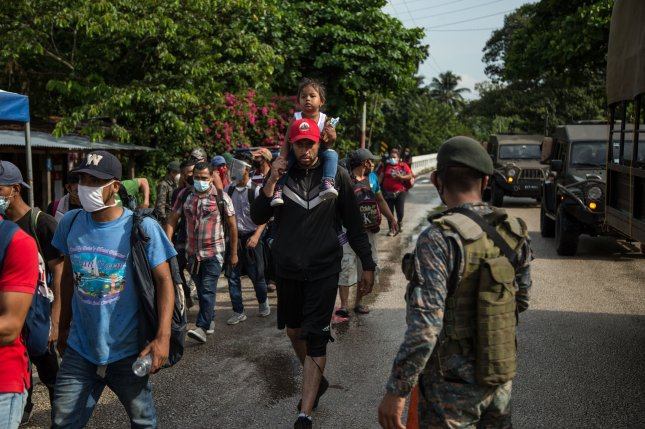 Honduran migrants seeking to reach the United States walked through Poptun, Guatemala, on Friday toward the El Ceibo border with Mexico before being detained by Guatemalan soldiers. Photo by Esteban Biba/EPA-EFE