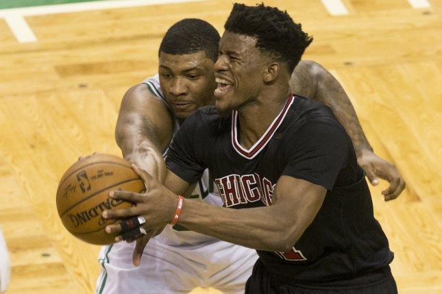 Chicago Bulls forward Jimmy Butler (R) keeps the ball away from Boston Celtics guard Marcus Smart (L) during the first half of their NBA Eastern Conference first round playoff series game at the TD Garden Sunday in Boston, Mass. Photo by C.J. Gunther/EPA