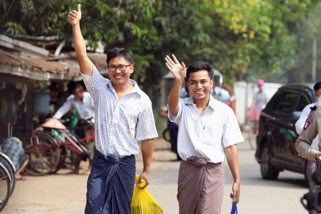 Reuters reporters Wa Lone (L) and Kyaw Soe Oo (R) gesture as they walk to Insein prison gate after being freed, in Yangon, Myanmar. Photo by Ann Wang/EPA-EFE