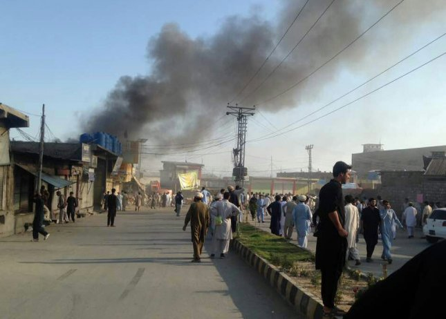 Smoke billows from the scene of a bomb blast in Parachinar, Pakistan, on Friday. More than 80 people were killed in separate attacks in three major cities in Pakistan including a suicide bombing near the chief of police's office, twin bomb blasts at a crowded market and an attack on a group of police officers by gunmen. Photo by STR/EPA