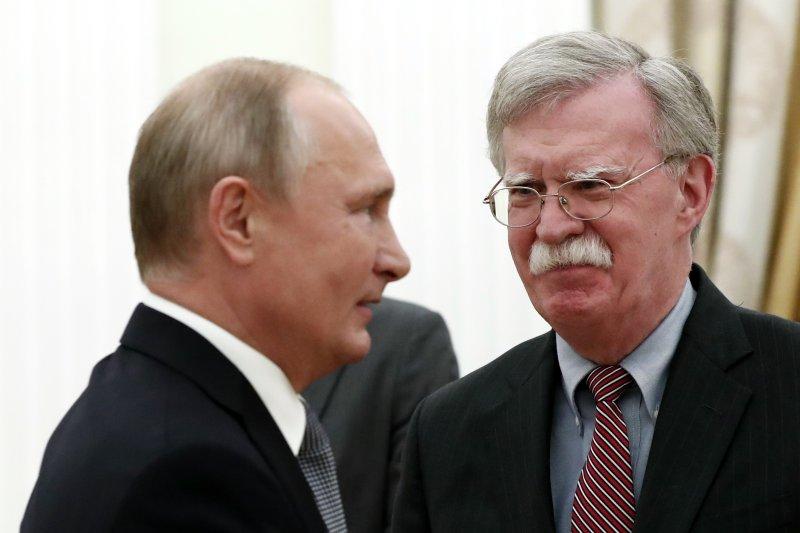 Russian President Vladimir Putin (L) meets with U.S. National Security Adviser John Bolton (R) in the Kremlin on Oct. 23. Photo by Maxim Shipenkov/EPA Pool