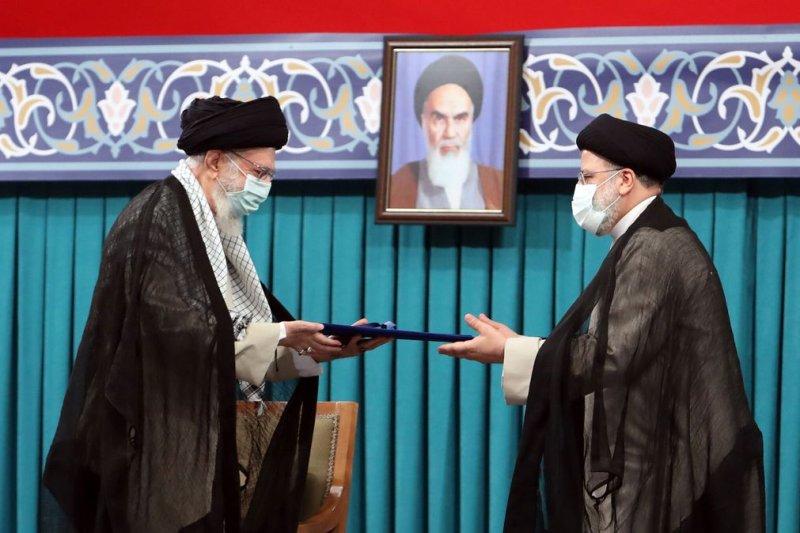 Iranian religious leader Ali khamenei hands over the presidential precept to new Iranian president Ebrahim Raisi (R) during a ceremony Tuesday in Tehran, Iran. Photo courtesy Iranian Supreme Leader Office/EPA-EFE