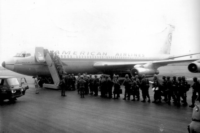 Members of the 101st Airborne Division board an American Airlines Astrojet Boeing 707 to leave for the Vietnam War at Campbell Army Airfield, Fort Campbell, Kentucky in June 1966. On January 25, 1959, the first scheduled transcontinental passenger jet flight took place, a non-stop American Airlines trip from California to New York in a Boeing 707 similar to the one pictured. File Photo courtesy of the U.S. Army