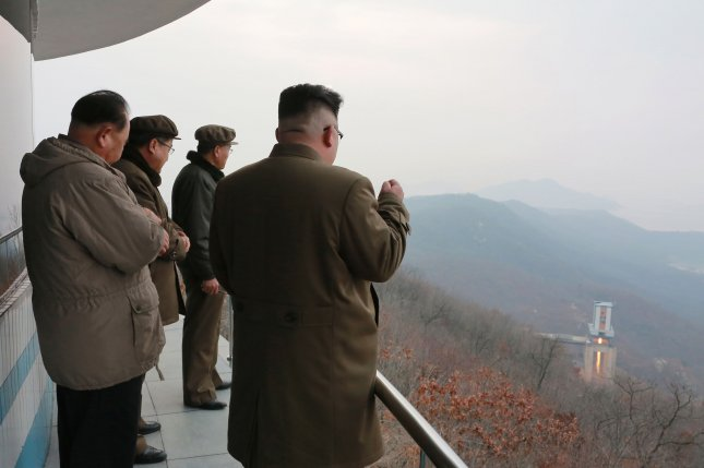 North Korean leader Kim Jong Un (R) shown in a photo of the Sohae satellite launch facility issued in 2017. Activity is up at the long-range missile launch site, according to U.S. analysts. File Photo by KCNA/EPA