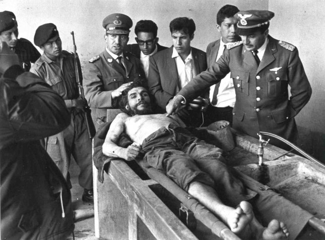 Ernesto Che Guevara's body is prepared for public display following his capture and execution by Bolivian troops in 1967. Photo by Freddy Alborta/UPI
