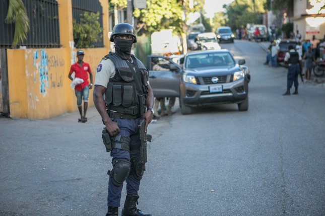 Police surrounded the area where senator-elect Guy Philippe was arrested a few minutes before in Port-au-Prince, Haiti, on January 5, 2017. Philippe, who is wanted by the United States for cocaine trafficking and money laundering, was arrested by Haitian anti-drug police. Photo by Bahare Khodabande/European Pressphoto Agency