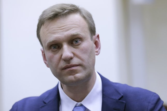 Russian opposition leader Alexei Navalny attends a procedure Sunday to submit documents for his registration as a candidate for Russian presidency at the Russian Central Election Commission headquarters in Moscow. The next day the CEC said it denied his application because of an embezzlement conviction. Photo by Maxim Shipenkov/EPA