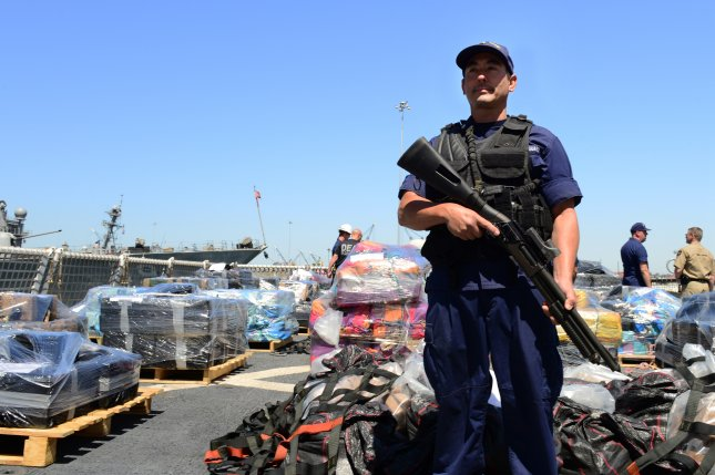 A U.S. Coast Guard crewman guards more than 28,000 pounds of cocaine at Naval Base San Diego in California on April 16, 2015. Federal prosecutors on Thursday charged a Honduras police official with helping traffic tons of cocaine into the United States over the years. File Photo by Petty Officer 2nd Class Connie Terrell/U.S. Coast Guard/UPI