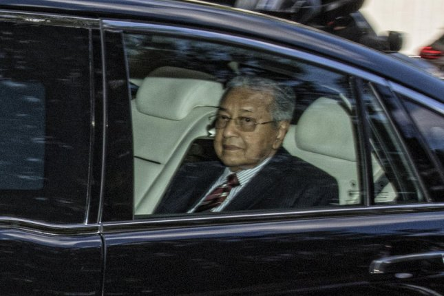 Malaysian Prime Minister Mahathir Mohamad travels to the National Palace in Kuala Lumpur on Monday after turning in his resignation. Photo by Ahmad Yusni/EPA-EFE