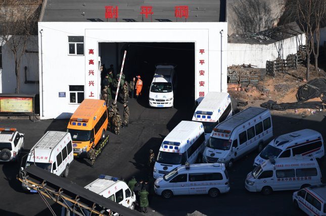 Rescuers gather at Lijiagou coal mine of the Baiji Mining Co., Ltd. in Shenmu City, Shaanxi province on Sunday. The death toll in a coal mine roof collapse has risen to 21, ccording to state media reports. Photo by EPA/Xinhua