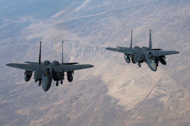 Two U.S. Air Force F-15 Strike Eagles fly in formation after receiving fuel from a KC-135 Stratotanker assigned to the 28th Expeditionary Air Refueling Squadron, Al Udeid Air Base, Qatar, on Oct. 10, 2019. Photo by Staff Sgt. Matthew Lotz/U.S. Air Force