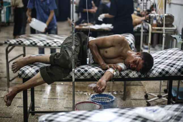 A young Syrian man receives medical treatment at a field hospital in July 2016. The Syrian civil war has devastated the country for more than half a decade. On Tuesday, a United Nations spokesperson said pro-regime forces are accused of carrying out on the spot extrajudicial killings of civilians. File Photo by Mohammed Badra/European Pressphoto Agency