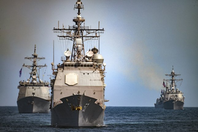 The guided-missile cruiser USS Lake Champlain (CG 57), center, leads the Republic of Korea destroyers Sejong the Great (DDG 991), left, and Yang Manchun (DDH 973) while transiting the Western Pacific on May 3, 2017. The U.S. Navy will receive Link-11/Link-22 data terminal sets from Leonardo DRS, which allow for communication between air-, land- and sea-based vessels. Photo by Z.A. Landers/U.S. Navy/UPI