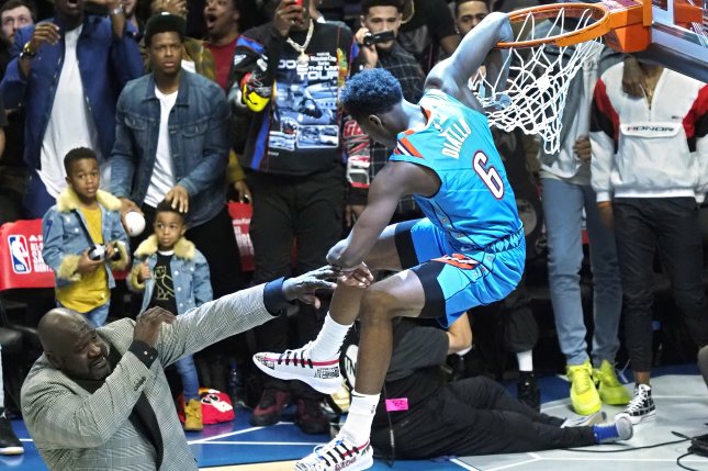 Oklahoma City player Hamidou Diallo (R) dunks over Shaquille O'Neal (L) in the Slam Dunk Contest during All-Star Weekend on Saturday at the Spectrum Center in Charlotte, North Carolina. Photo by John G. Mabanglo/EPA-EFE