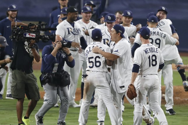 Tampa Bay Rays players celebrate after beating the Houston Astros in Game 7 of the American League Championship Series on Saturday night at Petco Park in San Diego, Calif. Photo by Adam Davis/EPA-EFE
