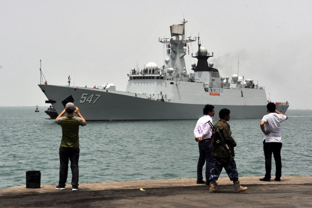 Yemenis see off a Chinese navy frigate at the western port city of Hodeidah, Yemen, on April 6, 2015. The Saudi-led coalition fighting in Yemen said it will keep the port open for humanitarian aid. File Photo by Stringer/EPA