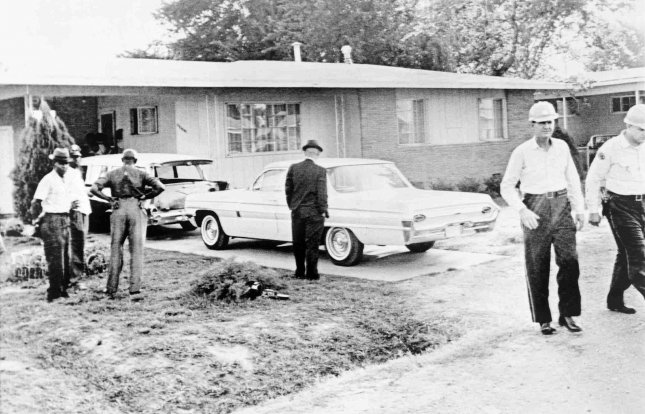 Medgar Evers, field secretary for the NAACP, was shot to death by a sniper early June 12, 1963, outside his home in Jackson, Miss. Evers had just stepped out of his car (rear) and started toward the carport when he was hit in the back by a high-powered rifle. UPI File Photo