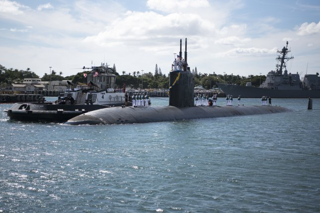 The Los Angeles-class fast-attack submarine USS Columbia returns to the submarine piers of Joint Base Pearl Harbor-Hickam in 2016. Photo by Petty Officer 2nd Class Michael H. Lee/U.S. Navy