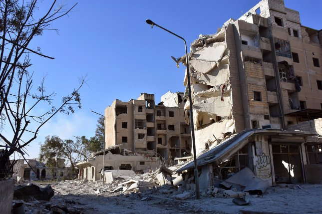 Fighting has devastated buildings in Aleppo's eastern Masaken Hanano area in Aleppo province, Syria, shown in this photo from November. Photo courtesy of Syrian Arab News Agency/EPA