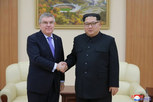 An undated photo released by the North Korean Central News Agency, the state news agency of North Korea, shows North Korean leader Kim Jong-un (R) meeting with Thomas Bach, president of the International Olympic Committee (IOC) during his visit to Pyongyang, North Korea. Photo by KCNA.