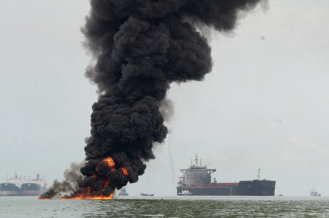 Oil-spill Flame Circulates Darkened Interface city; 4 Deceased