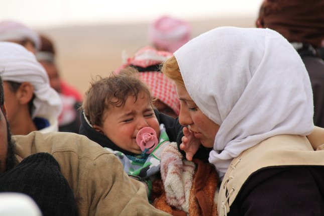 People flee fighting areas as coalition forces battle with Islamic State militants near Raqqa, Syria. French officials plan to repatriate some of the approximately 150 children of IS fighters held in Syria. Photo by STR/EPA